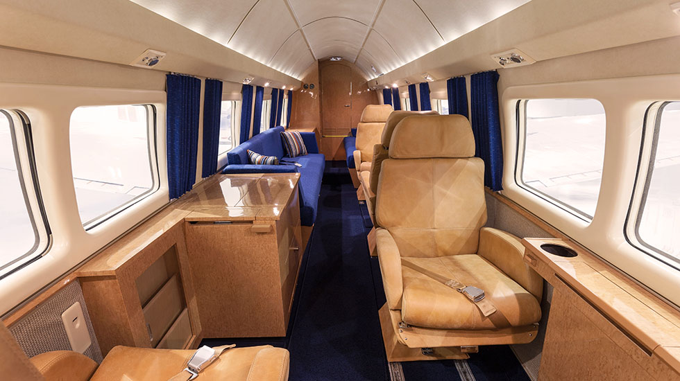 The Howard offers interior beauty to go with its brawn. With a six-foot, two-inch stand-up cabin, leather seats, two divans, maple cabinets and blue carpets and curtains, passengers will arive in plush 1960s style.